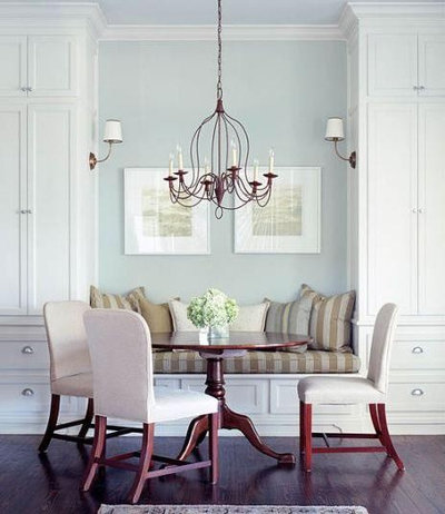 Built In Cabinetry Provides A Unique Seating Opportunity In This Dining  Area. I Love The Use Of Sconces On The Sides Of The Tall Cabinets.