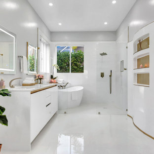 Trendy white tile white floor and double-sink bathroom photo in Miami with flat-panel cabinets, white cabinets, gray walls, an undermount sink, white countertops and a built-in vanity