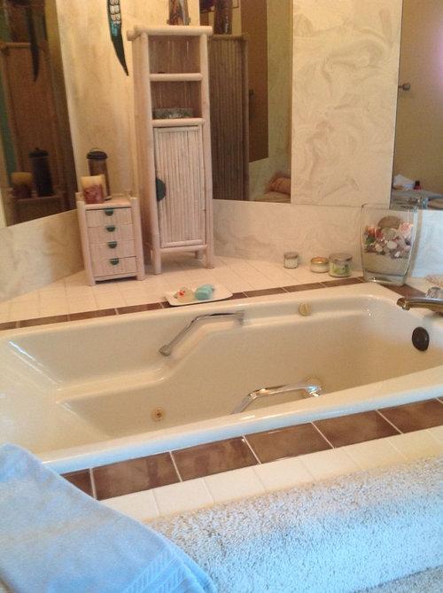 Keep our sunken cast iron soaking tub? Finish very good. 1982.