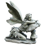 Napco - Fairy On Mushroom Garden Figurine, Green, Green - Make an angelic statement in your garden or on your patio with the Fairy on Mushroom Garden Figurine. Made with resin, this decorative garden piece boasts a green finish and features a winged fairy resting her body on a mushroom. With tiny, intricate detail, this piece blends well amongst your flower beds.