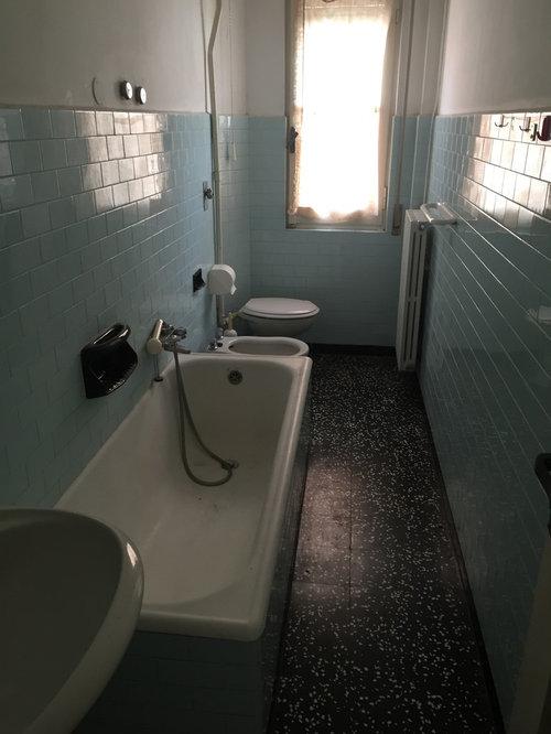 Doccia davanti alla finestra - Bagno stretto e lungo con doccia ...