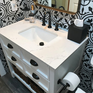 This is an example of a small traditional master bathroom in Other with shaker cabinets, white cabinets, an alcove tub, an alcove shower, a two-piece toilet, black and white tile, ceramic tile, white walls, wood-look tile, an undermount sink, quartzite benchtops, black floor, a sliding shower screen, white benchtops, a single vanity, a freestanding vanity and planked wall panelling.