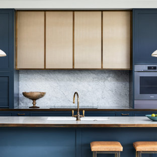 Inspiration for a mid-sized transitional galley eat-in kitchen in Other with a double-bowl sink, shaker cabinets, blue cabinets, marble benchtops, grey splashback, marble splashback, stainless steel appliances, marble floors, with island, grey floor, grey benchtop and wood.