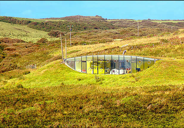 Internal Functional Areas Are Contained Within Colorful Prefabricated Pods.  A Large, Curved Sofa Looks Out Over The Dizzying Expansive Views Of St.  Brides ...