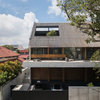 A Back-to-Back House With a Show-Stopping Roof
