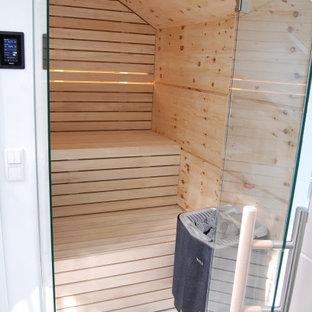 Idee per una piccola palestra multiuso nordica con soffitto in legno