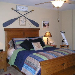 Example of an eclectic bedroom design in Charlotte