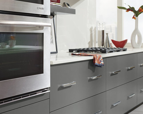 GRAY CABINETS WITH A RED KITCHEN ISLAND - Kitchen Cabinetry