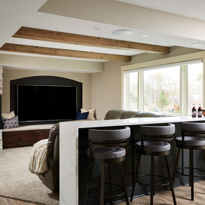 Example of a large transitional vinyl floor and brown floor home theater design in Minneapolis with gray walls