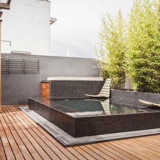 Imagen de piscina elevada, contemporánea, pequeña, rectangular, en azotea, con entablado