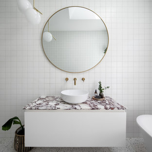 Inspiration for a mid-sized contemporary kids bathroom in Melbourne with white cabinets, a claw-foot tub, an open shower, white tile, porcelain tile, terrazzo floors, a pedestal sink, marble benchtops, white floor, an open shower, pink benchtops, a single vanity and a floating vanity.