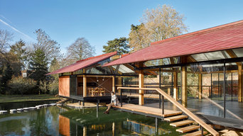 Japanese inspired pergola extension in Henley upon Thames with a man made lake.