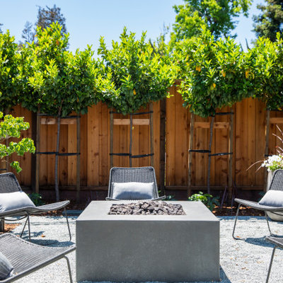Inspiration for a large country backyard gravel patio remodel in San Francisco with no cover