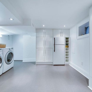 Mid-sized transitional cork floor dedicated laundry room photo in Toronto with an undermount sink, shaker cabinets, white cabinets, quartz countertops, white walls and a side-by-side washer/dryer