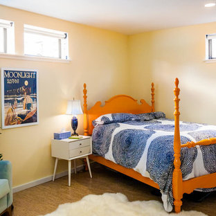 Mid-sized tropical master bedroom in San Francisco with yellow walls, cork floors, no fireplace and brown floor.