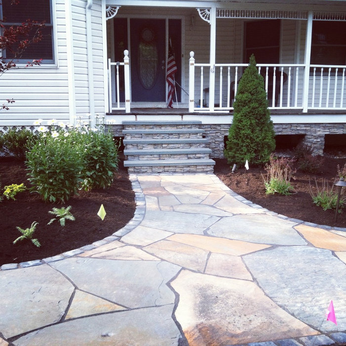freeform natural bluestone walkway with landscpe