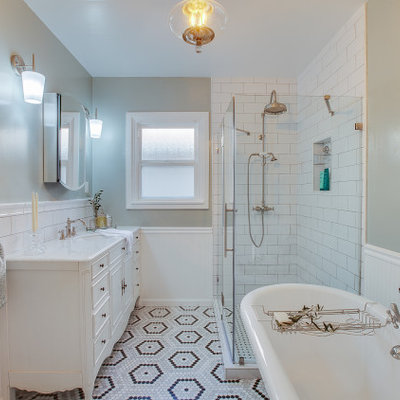 Inspiration for a small timeless master green tile marble floor, multicolored floor, single-sink and wainscoting bathroom remodel in Los Angeles with furniture-like cabinets, white cabinets, a one-piece toilet, green walls, a drop-in sink, marble countertops, a hinged shower door, white countertops and a freestanding vanity
