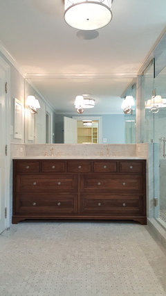 heres a recently completed walnut beaded inset master bath vanity and behind master closet we designbuilt