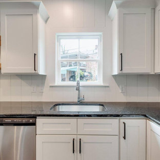 Inspiration for a large transitional u-shaped open plan kitchen in Other with an undermount sink, shaker cabinets, white cabinets, granite benchtops, white splashback, shiplap splashback, stainless steel appliances, medium hardwood floors and black benchtop.