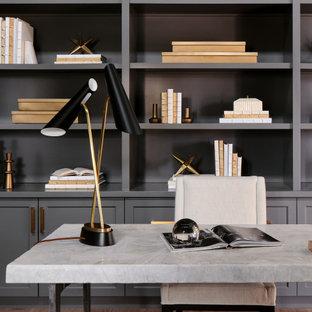 На фото: рабочее место среднего размера в стиле неоклассика (современная классика) с серыми стенами, светлым паркетным полом, отдельно стоящим рабочим столом, серым полом, потолком с обоями и панелями на стенах
