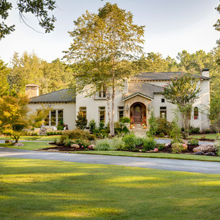 Design ideas for a large country home design in Little Rock.
