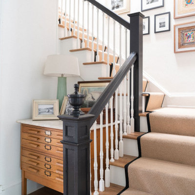 Staircase - transitional carpeted l-shaped wood railing staircase idea in Jacksonville with carpeted risers