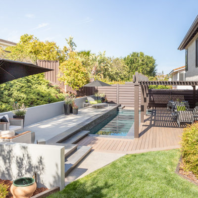 Inspiration for a contemporary rectangular pool remodel in Los Angeles with decking