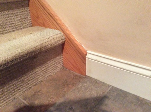 Baseboard transition from floor to stairs