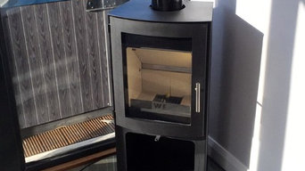 Westfire wood burning stove + glass hearth