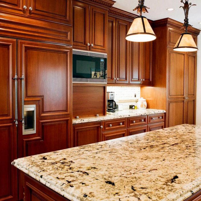 Dark wood custom Cabinets and light Granite Countertops