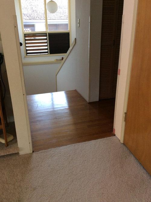 Help With Solid Oak Hallway Next To Gray Laminate Wood Floor