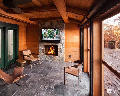 Foto e idee per verande piccola veranda con camino classico for Proiettato in veranda con camino