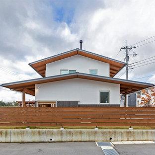 他の地域の和モダンなおしゃれな家の外観 (漆喰サイディング、長方形) の写真