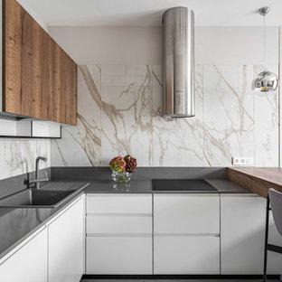 Источник вдохновения для домашнего уюта: п-образная кухня среднего размера в современном стиле с обеденным столом, полом из керамогранита и полуостровом