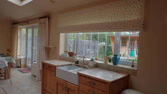 Spotty curtains and roman blind