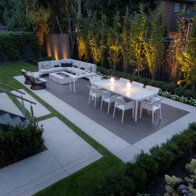 Patio - mid-sized 1950s backyard concrete patio idea in Toronto with no cover