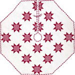 "VHC Brands - Emmie Red 60"" Patchwork Tree Skirt - Countrify your Christmas this year with the 60"" Emmie Red Patchwork Tree Skirt. A holiday significant 7 rows of 8-point stars are placed on a bright white background. Reverses to the red and white check found inside the stars. 100% cotton, hand-quilted."