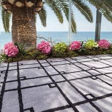 Terrazas chic decoradas con alfombras de exterior