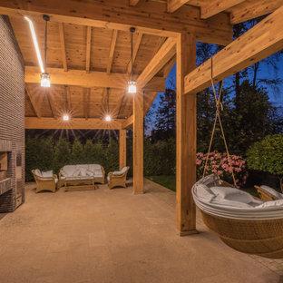 Foto di una grande terrazza country in cortile e a piano terra con un tetto a sbalzo