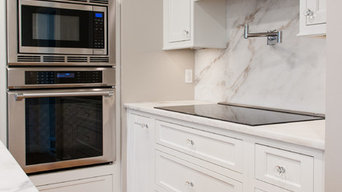 White Inset Cabinets with Imperial Danby Marble Tops