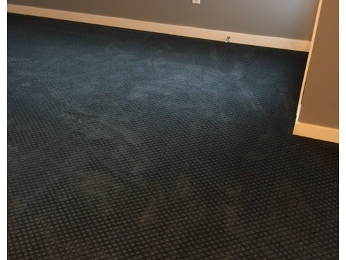 Help! My brand new black carpet looks green and blue!