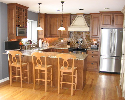 Traditional kitchen with brown backsplash design ideas & remodel ...