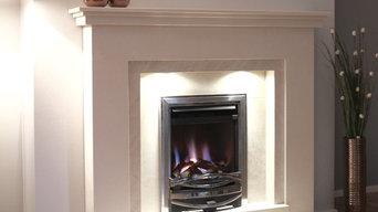 Limestone fireplace with a Gas fire