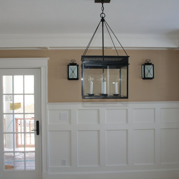 Dining Room With Custom Hand Crafted Wainscoting and Tray Ceilings