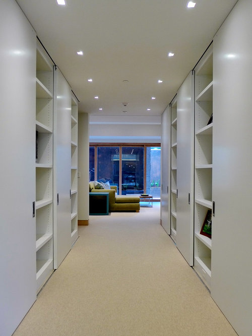 Example Of A Large Trendy Gender Neutral Reach In Closet Design In San  Francisco