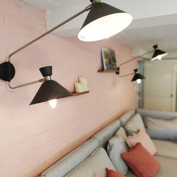 Un espace bibliothèque & détente dans un sous-sol