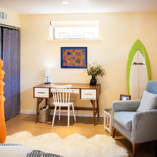 This is an example of a mid-sized tropical master bedroom in San Francisco with yellow walls, cork floors, no fireplace and brown floor.