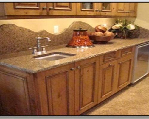 granite vanity top with custom cut granite backsplash