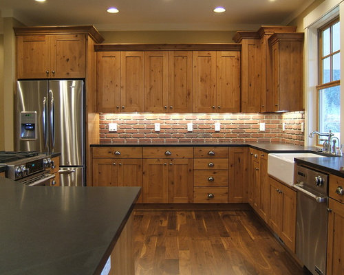 Rustic Kitchen Idea In Portland With Stainless Steel Appliances, A  Farmhouse Sink, Recessed
