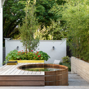 Outdoor shower deck - small modern backyard ground level outdoor shower deck idea in Portland with no cover